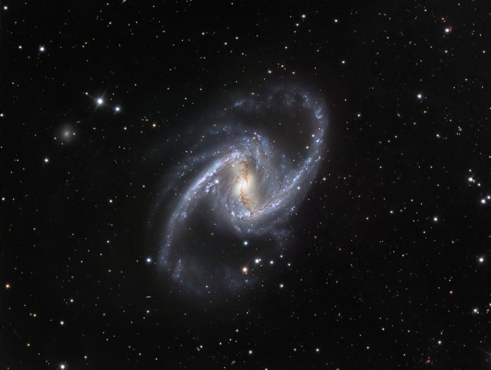 great barred spiral galaxy,fornax constellation,supermassive black hole