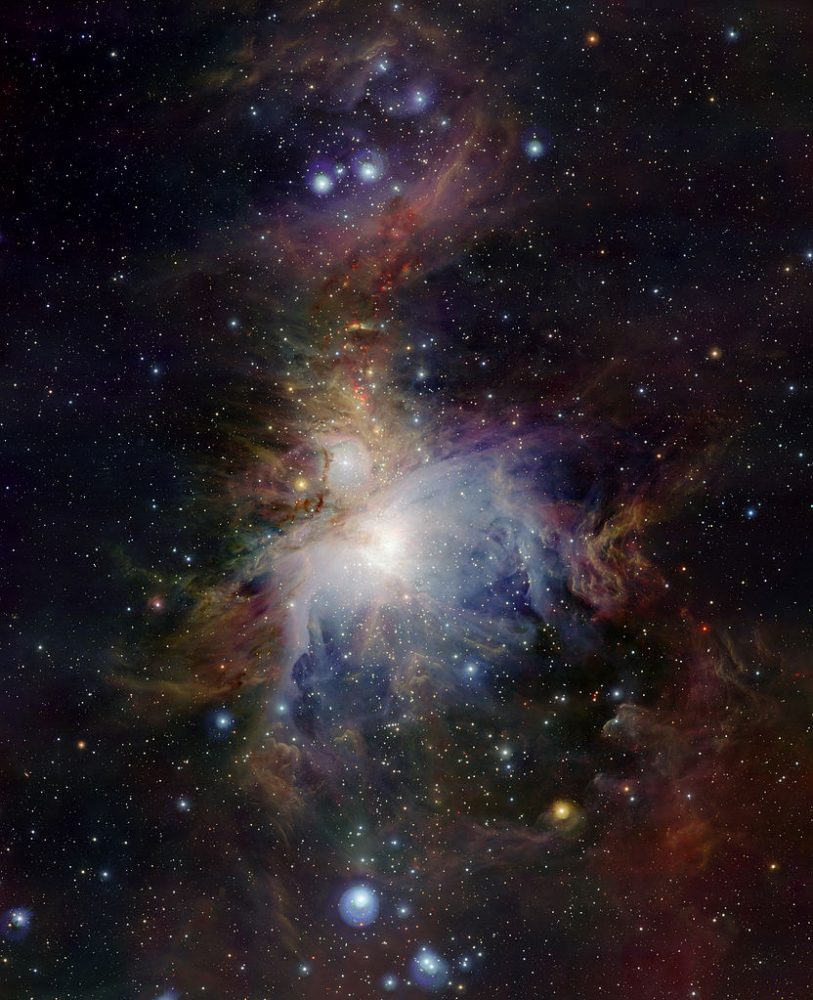 This wide-field view of the Orion Nebula (Messier 42), lying about 1350 light-years from Earth, was taken with the VISTA infrared survey telescope at ESO's Paranal Observatory in Chile. The new telescope's huge field of view allows the whole nebula and its surroundings to be imaged in a single picture and its infrared vision also means that it can peer deep into the normally hidden dusty regions and reveal the curious antics of the very active young stars buried there. This image was created from images taken through Z, J and Ks filters in the near-infrared part of the spectrum. The exposure times were ten minutes per filter. The image covers a region of sky about one degree by 1.5 degrees. Image: ESO/J. Emerson/VISTA. Acknowledgment: Cambridge Astronomical Survey Unit
