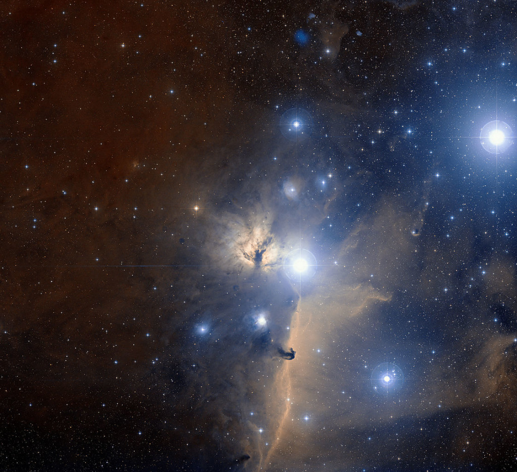 This spectacular visible light wide-field view of part of the famous belt of the great celestial hunter Orion shows the region of the sky around the Flame Nebula. The whole image is filled with glowing gas clouds illuminated by hot blue young stars. It was created from photographs in red and blue light forming part of the Digitized Sky Survey 2. The field of view is approximately three degrees. Image: ESO and Digitized Sky Survey 2