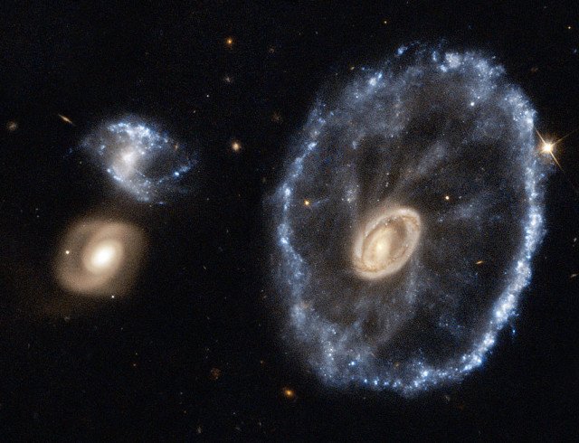 ring galaxy,lenticular galaxy,sculptor,colliding galaxies